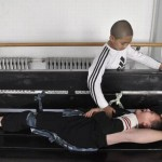 A student helps his schoolmate stretch during a physical training session in Peking Opera at an art school affliated to Shenyang Normal University in Shenyang