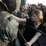 "A participant is restrained by Russian riot police during the ""march of the million"" opposition protest in central Moscow"